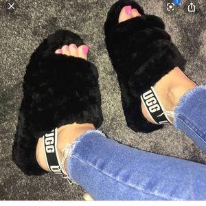 Black Ugg slides